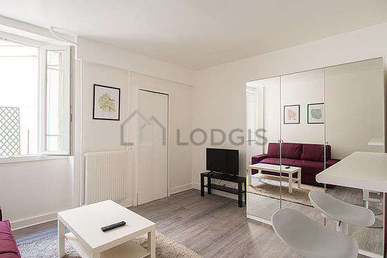 Very quiet living room furnished with tv, wardrobe, cupboard, 1 chair(s)