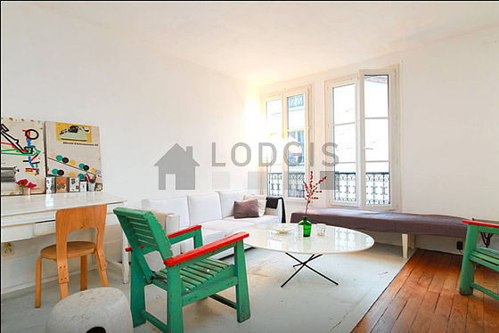 Quiet living room furnished with 1 sofabed(s) of 140cm, tv, 3 armchair(s), 4 chair(s)