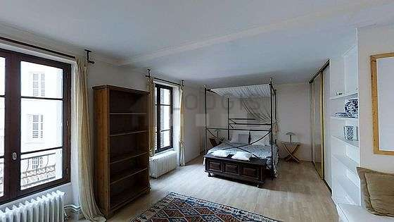 Very bright bedroom equipped with sofa, 1 chair(s)