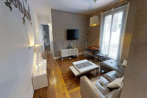 Quiet living room furnished with tv, hi-fi stereo, storage space, 2 chair(s)