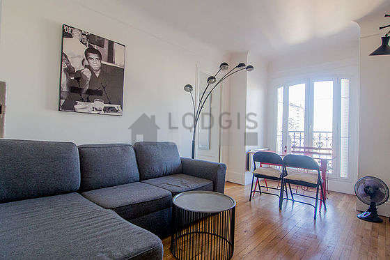Very quiet living room furnished with tv, storage space, 1 chair(s)