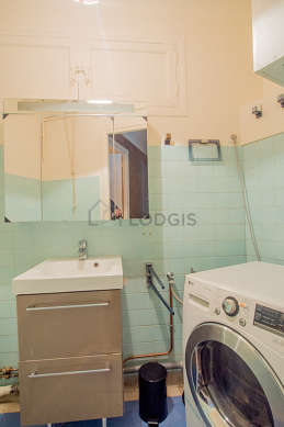 Bathroom equipped with dryer, shelves