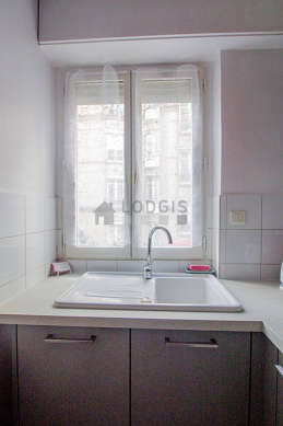 Kitchen where you can have dinner for 2 person(s) equipped with washing machine, refrigerator, extractor hood, crockery