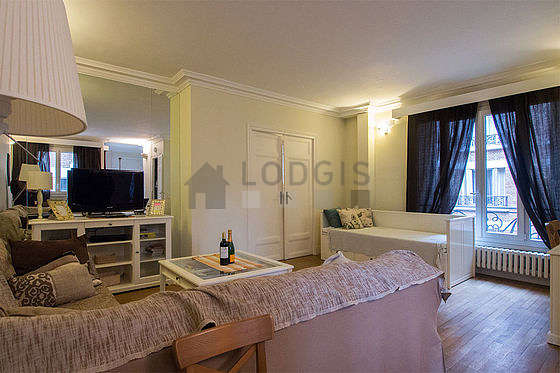 Very quiet living room furnished with 1 bed(s) of 80cm, tv, 5 chair(s)