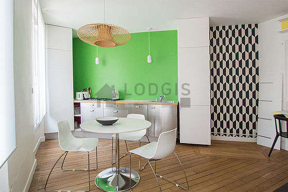 Great kitchenopens on the living room with woodenfloor