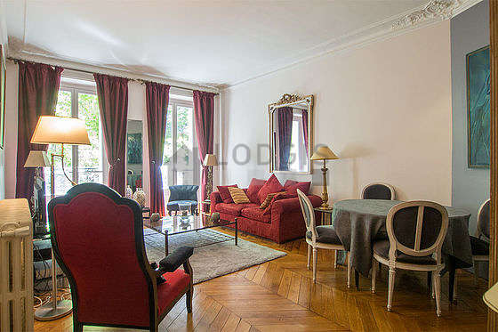 Living room furnished with tv, hi-fi stereo, 3 armchair(s), 6 chair(s)