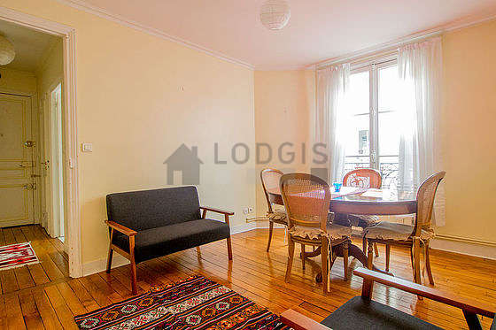 Very quiet living room furnished with sofa, 1 armchair(s), 4 chair(s)