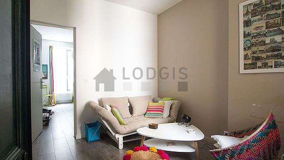 Quiet living room furnished with sofa, 1 armchair(s)