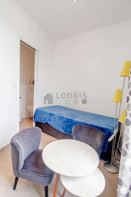 Very quiet living room furnished with 1 bed(s) of 90cm, coffee table, wardrobe, 2 chair(s)