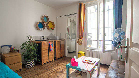 Very quiet living room furnished with 1 bed(s) of 140cm, sofa, coffee table, closet