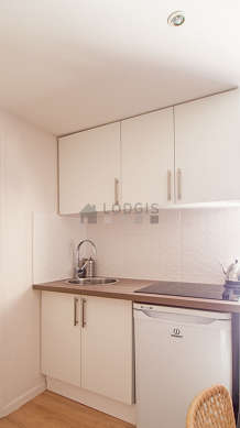 Kitchen equipped with oven, kettle, crockery