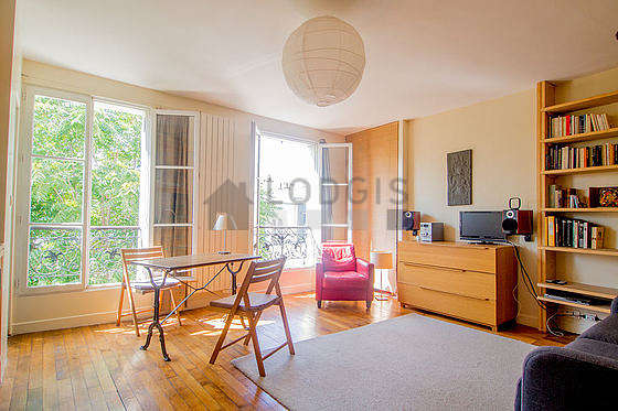 Very quiet living room furnished with 1 sofabed(s) of 140cm, tv, wardrobe, 2 chair(s)