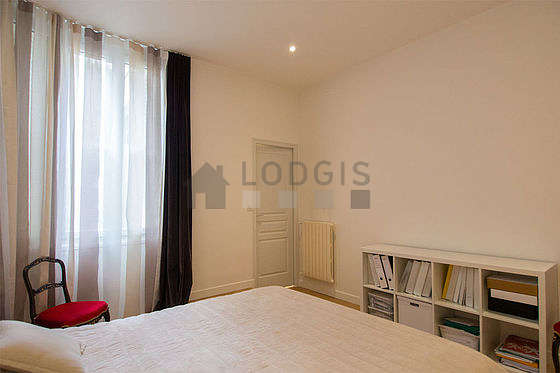 Bedroom equipped with wardrobe, cupboard, 2 chair(s)