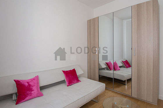 Bright bedroom equipped with tv, sofa