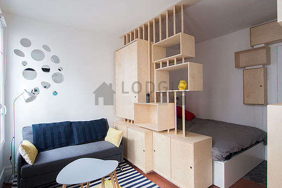 Quiet living room furnished with 1 bed(s) of 140cm, tv, cupboard