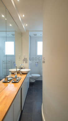 Pleasant and bright bathroom with double-glazed windows and with tilefloor