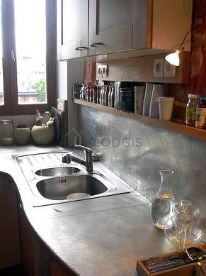 Kitchen where you can have dinner for 3 person(s) equipped with dishwasher, hob, refrigerator, crockery