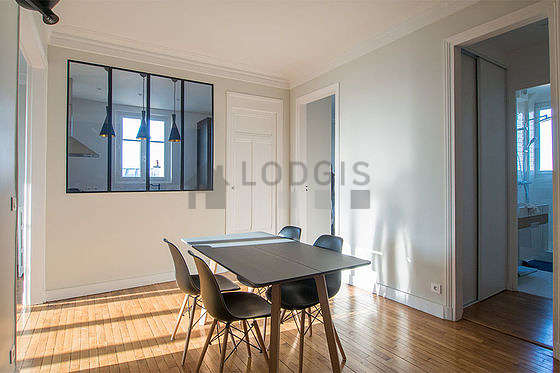 Dining room of 13m² equipped with dining table, storage space