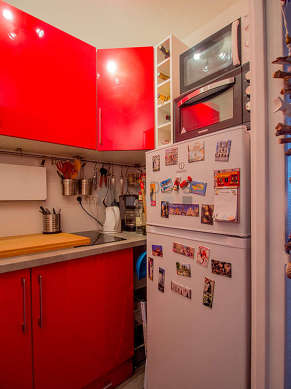 Kitchen equipped with hob, refrigerator