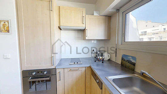 Kitchen where you can have dinner for 2 person(s) equipped with washing machine, dryer, freezer, extractor hood