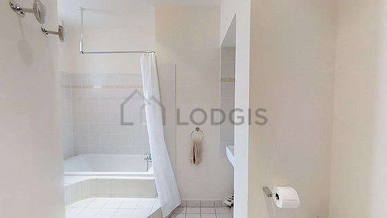 Pleasant and bright bathroom with windows and with tilefloor