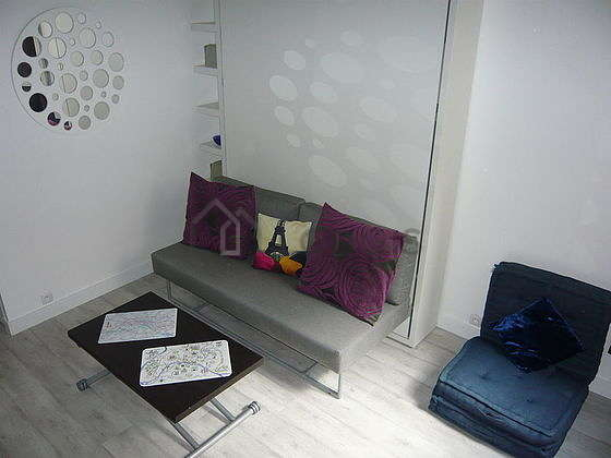 Very quiet living room furnished with 1 murphy bed(s) of 160cm, tv