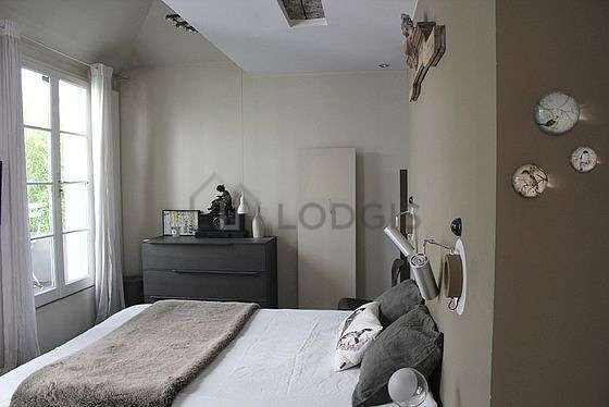 Bright bedroom equipped with dvd player, bedside table