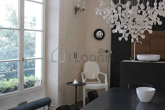 Dining room of 20m² equipped with dining table, cupboard