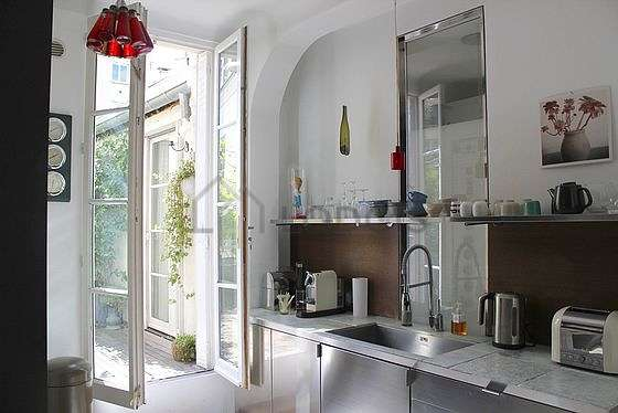 Kitchen where you can have dinner for 2 person(s) equipped with washing machine, refrigerator, crockery, stool