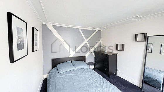 Bedroom with the carpetingfloor