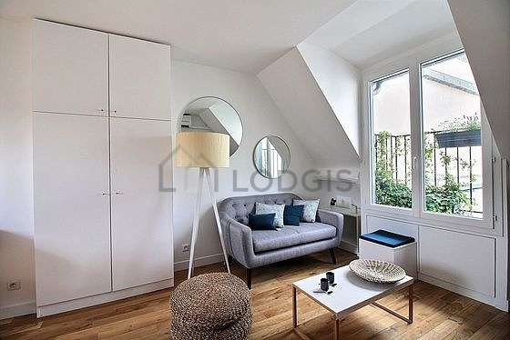 Very quiet living room furnished with air conditioning, tv, cupboard