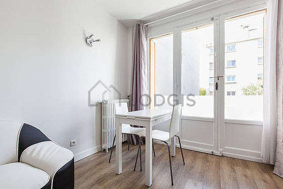 Very quiet living room furnished with tv, fan, 1 chair(s)
