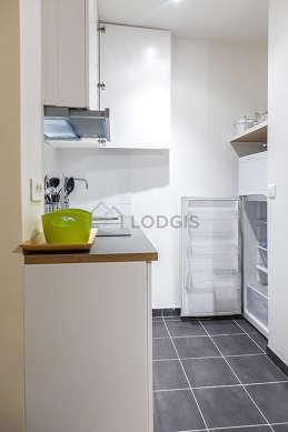 Kitchen equipped with refrigerator, freezer, crockery