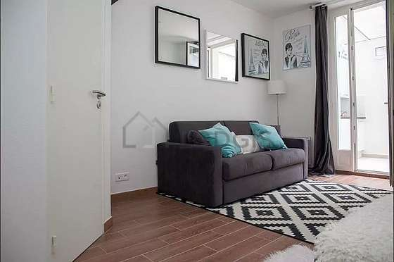 Quiet living room furnished with 1 sofabed(s) of 140cm, tv, closet, storage space