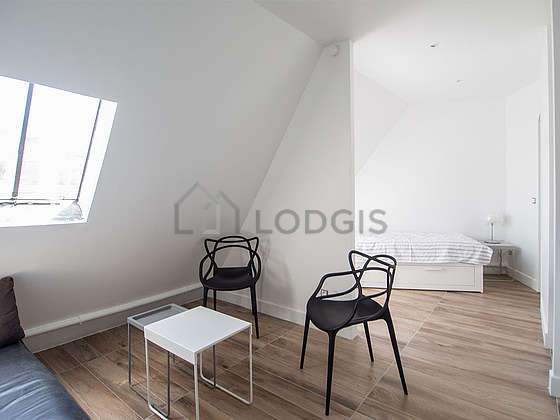 Very quiet living room furnished with sofa, coffee table, 2 chair(s)