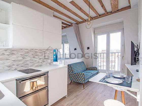 Kitchen equipped with dishwasher, refrigerator, crockery