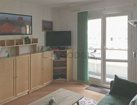 Quiet living room furnished with 1 sofabed(s) of 140cm, tv, dvd player, fan