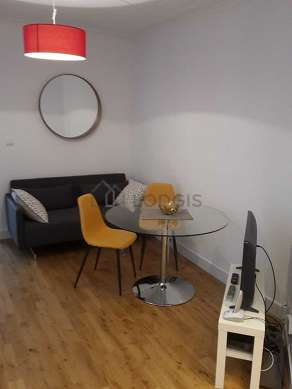 Quiet living room furnished with tv, wardrobe, cupboard, 2 chair(s)