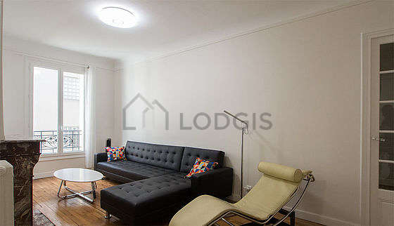 Very quiet living room furnished with tv, hi-fi stereo, 1 armchair(s)