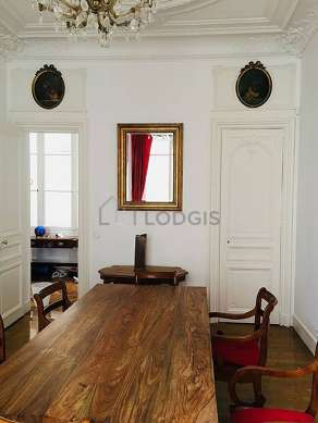 Dining room with woodenfloor for 8 person(s)