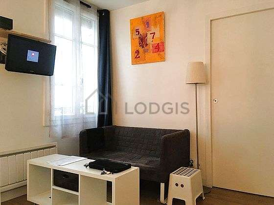 Very quiet living room furnished with tv, closet, storage space