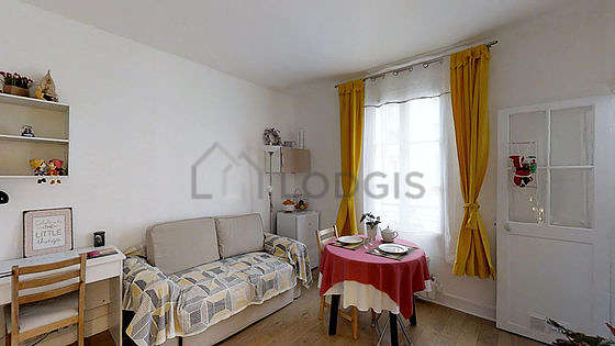 Very quiet living room furnished with tv, fan, 1 armchair(s), 2 chair(s)