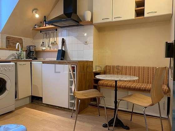 Kitchen equipped with washing machine, freezer, crockery