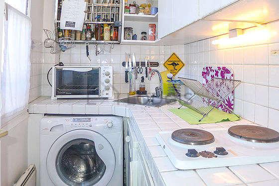Kitchen equipped with washing machine, refrigerator, freezer