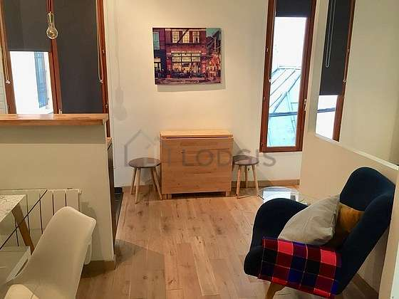Very quiet living room furnished with home cinema, tv, fan, 1 armchair(s)