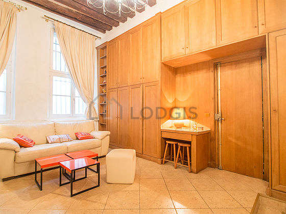 Very quiet living room furnished with 1 sofabed(s) of 160cm, hi-fi stereo, cupboard, 4 chair(s)