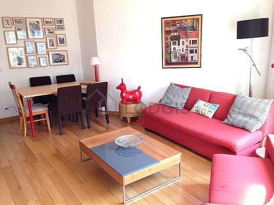 Quiet living room furnished with home cinema, tv, hi-fi stereo, 1 armchair(s)
