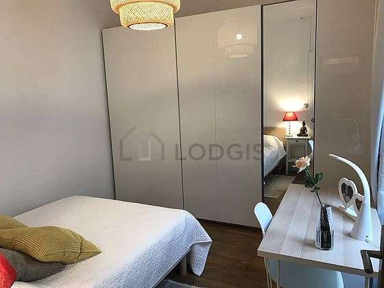 Bright bedroom equipped with desk, wardrobe, cupboard, 1 chair(s)