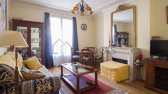 Quiet living room furnished with tv, closet, 4 chair(s)