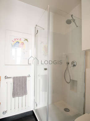 Bathroom equipped with washing machine, dryer, shelves